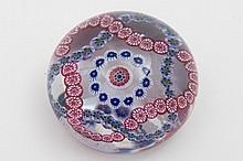 A Clichy garland paperweight: set with a central