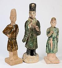 Three various pottery male tomb attendants: in