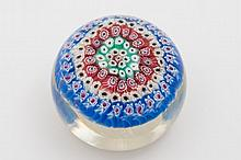 A glass concentric millefiori basket paperweight,