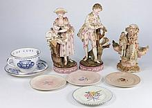 A pair of Continental porcelain figures, of a boy