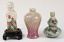 Three Chinese porcelain snuff bottles: one with
