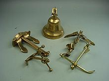 Four bronze and brass models of anchors and a