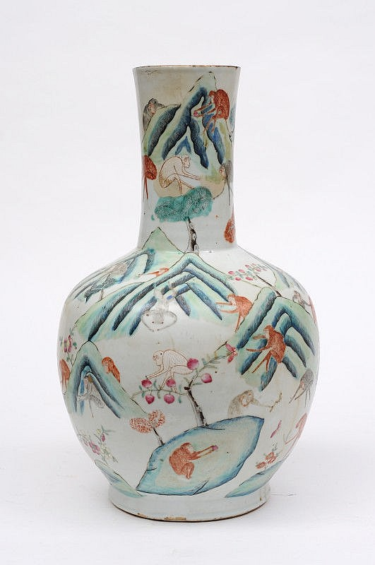 A Chinese porcelain bottle vase enamelled with
