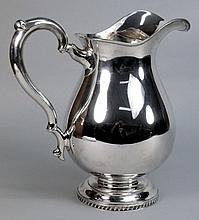 A sterling silver wine ewer: of baluster form with