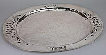 A plated Arts and Crafts oval tray:, with hammered