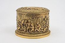 A Victorian gilt metal oval tea caddy: the hinged
