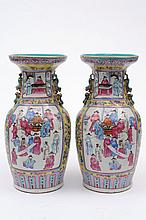 A pair of Canton famille rose baluster vases: each