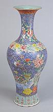 A Chinese famille rose baluster vase: decorated in