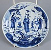 A Chinese blue and white saucer dish: painted with