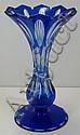 A blue overlay vase.