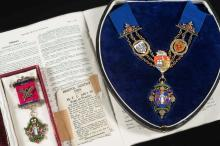 A cased silver gilt and enamel regalia for the Incorporated Dental Society