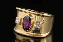 A ruby and diamond three-stone ring: with central oval ruby approximately 7