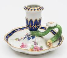 A Chelsea Derby porcelain chamberstick: with octofoil base and circular sco