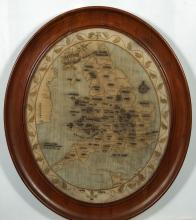 An early 19th century oval needlework map of Britain and Wales: with named