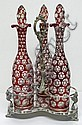 Three Victorian ruby glass decanters and stoppers,