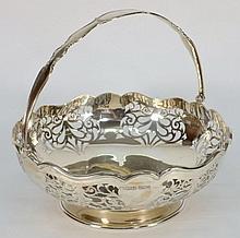 A George V silver swing handle basket, maker