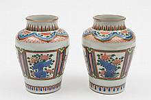 A pair of Chinese wucai baluster vases: in Wanli