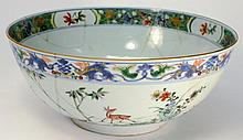 A Chinese porcelain punchbowl: decorated in the