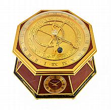 An octagonal gilt and lacquered brass and red marble veneered desk clock compendium, Kutchinsky, 20th century, comprising; an orrery with a quartz movement, a time piece with quartz movement, the dial signed 'Kutchinsky' a barometer, a hygrometer and