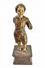 A late 17th century polychrome painted carved wooden figure depicting a young boy on a wooden plinth, (a.f.), 51cm high overall.  Illustrated