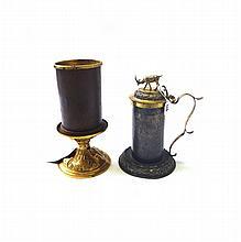 A gilt metal tankard, possibly 18th century Scandanavian, and an Italian gilt metal altar candlestick, 28cm high (2).