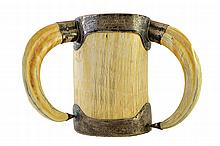 A large Victorian silver mounted ivory cup, London 1884, of cylindrical form with tusk handles and presentation engraved rim, 20.5cm high.  Illustrated