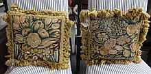 A group of eight cushions made from 17th century verdure tapestry fragments. (8)