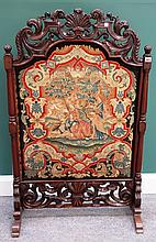 A William and Mary pierced and carved walnut framed tapestry fire screen, on later 19th century turned rosewood supports, 75cm wide x 121cm high.