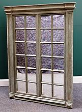 A 20th century green painted segmented wall mirror of 18th century architectural design, 118cm wide x 160cm high.