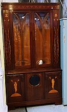 A 19th century Continental marquetry inlaid Art Nouveau display cabinet cupboard, the pair of bevelled glazed doors over three lower doors, the centre with lenticle, the flanking doors with female marquetry  decoration, 114cm wide x 206cm high.