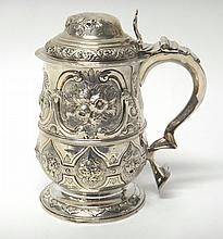 A George III silver tankard of baluster form, with later embossed decoration, London 1784, by Hester Bateman, 19cm high.