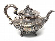 A Victorian silver teapot of squat melon form, with embossed floral decoration and scroll handle, London 1840, 872gms.
