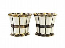 A pair of Danish silver gilt and white enamel beakers of flared form, detailed A. Michelsen, Copenhagen.  Illustrated
