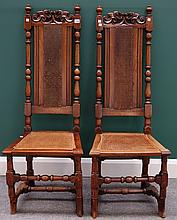 A pair of 17th century style walnut framed high back armchairs with turned supports.
