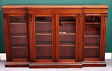 A Victorian walnut breakfront glazed four door bookcase on plinth base, 200cm wide x 124cm high.