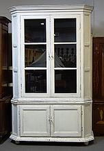 A 19th century and later white painted French display cabinet cupboard, the pair of glazed doors over pair of cupboards, on bun feet, 163cm wide x 255cm high.