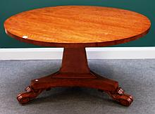 A William IV satinwood centre table, the circular snap top on flared triangular column and three scroll feet, 130cm wide.