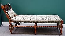 A William and Mary carved walnut framed cane upholstered day bed on barley-twist supports, 180cm wide.