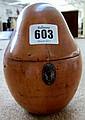 A George II fruit wood tea caddy of pear form,