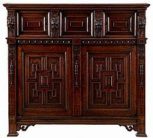 Bahut. Oak and mahogany. Three small and two large panelled doors. Carved d