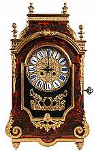 Mantelclock. Ebonised wood with 'Boulle' inlay of red tinted tortoise and c