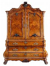 Cabinet. Mahogany and rootwood veneer. Vaulted cornice in relief. Two doors