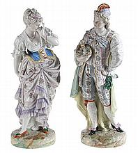 Young nobleman and lady. A pair of extremely large figurines in multi-colou