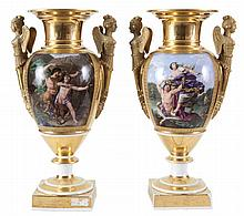 A pair of double-hanlded vases on foot.  Partly gilt Old Paris' porcela