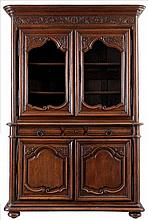 Display case. Oak. Four doors, three drawers. Rounded edges.  Carved de