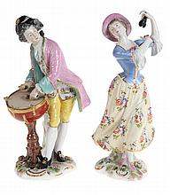 Musical, dancing couple. A pair of figures in multi-coloured painted porcel