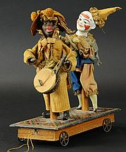 MINSTREL AND CLOWN ON PLATFORM PULL TOY