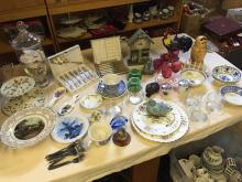 A selection of ceramics including cake stands and cranberry glass.