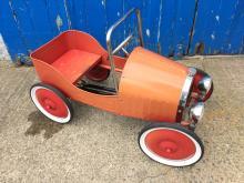 A child's pedal car.
