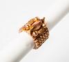 Yves SAINT LAURENT   Magnifique bracelet tank en métal doré, rosé orné d'une sculpture et des chiffres.